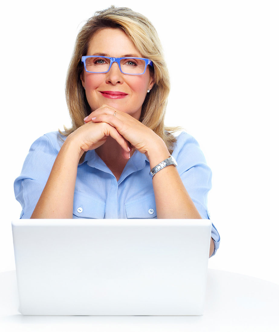 female business owner at computer looking at camera