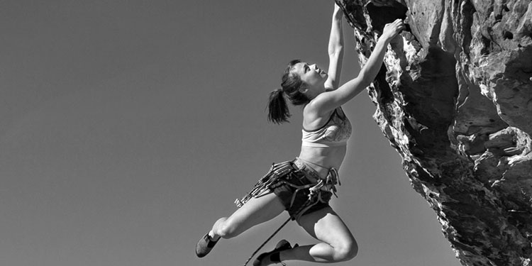 woman in exciting free rock climb